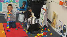 Students Interacting with Blocks