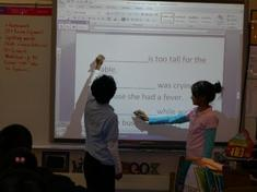 Stundents Interacting with a Smart Board
